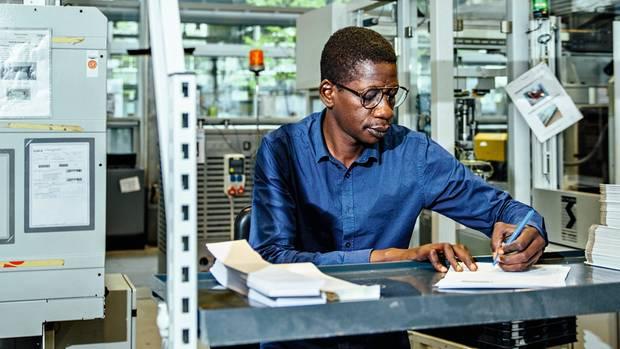 The factory in Radevormwald employs people from 27 nations. Operator Ahmadu Bah is from Sierra Leone.