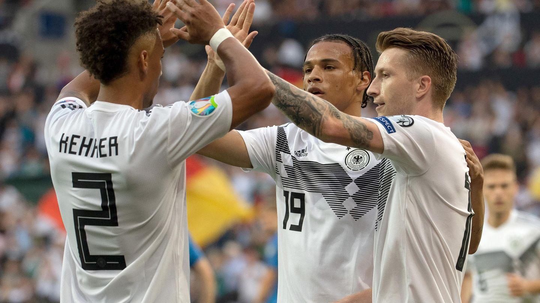 EM-Qualifikation: Deutschlands Thilo Kehrer, Leroy Sane und Torschütze Marco Reus bejubeln das 1:0