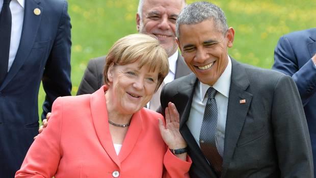 Merkel und Obama lachen