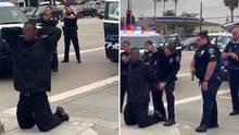 Mehrere Beamte richten ihre Waffen auf William Ewell, der mit erhobenen Händen am Boden kniet.