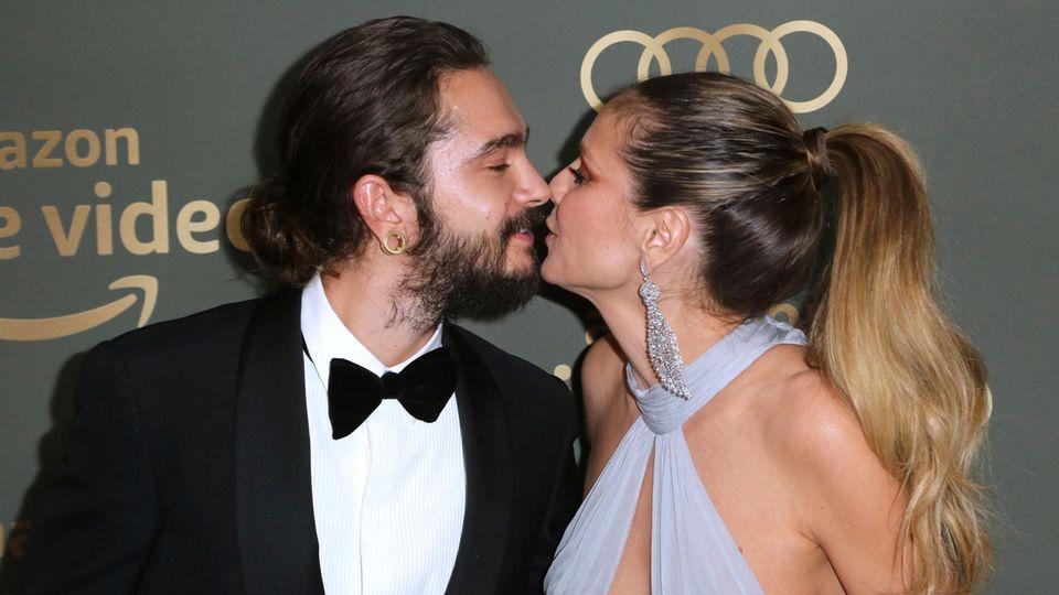 Tom Kaulitz und Heidi Klum küssen sich