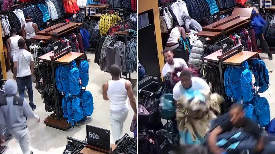 Zehn Männer gehen seelenruhig in einen Laden, dann reißen sie plötzlich die Waren aus den Schränken