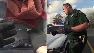 US-Cop schiebt Autofahrerin Drogen unter