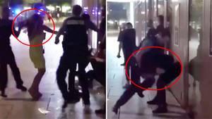 Eine Frau wird an den Haaren zu Boden gerissen, einem Mann mit den Knien in die Magengrube getreten.