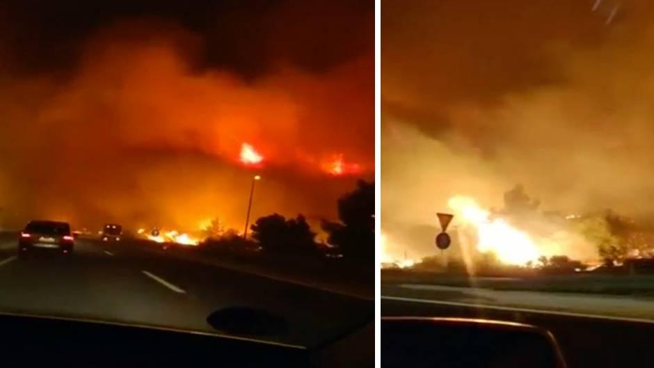 In der Nähe von Sibenik an der Adria schlugenFlammen eines Waldbrandes bis auf die Fahrbah