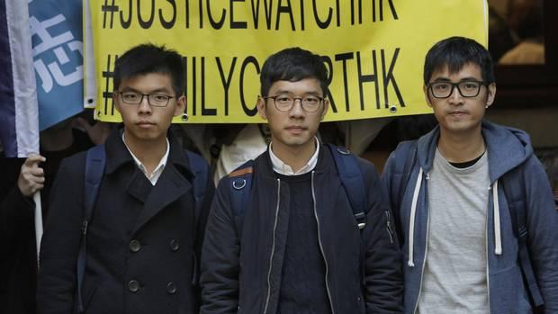 Joshua Wong, Nathan Law und AlexChow (v.l.) gehören zu den führenden Köpfen der aktuellen Proteste in Hongkong