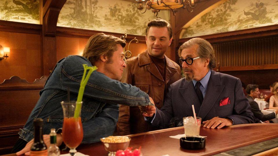 Filmszene mit Pitt, DiCaprio und Al Pacino (v.l.)