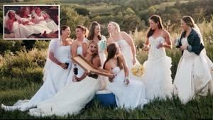 Acht Frauen in Brautkleidern lachen beim Pizzaessen – in den Händen halten sie Bierdosen.
