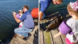 """Die vierjährige Josie ziehtmit ihrer """"Frozen""""-Angel einen Riesenfisch aus dem Wasser."""
