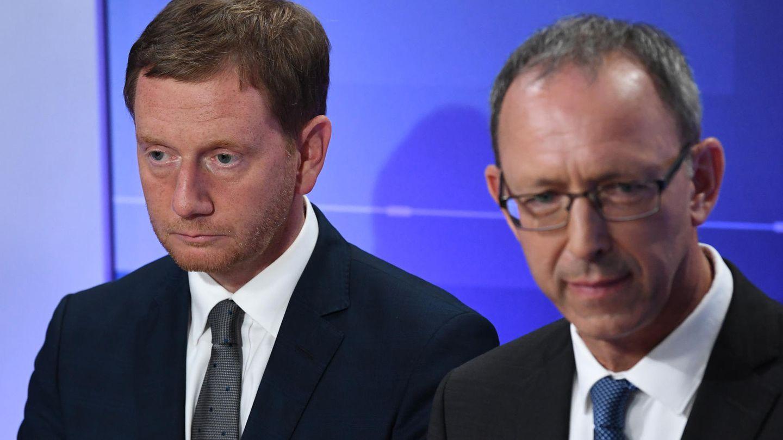 Michael Kretschmer von der CDU und Jörg Urban von der AfD würdigen sich keines Blickes