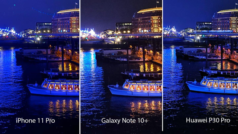 Die Spitzenmodelle im Vergleich. Bei dieser lichtstarken Nachtszenerie kommt das Galaxy Note 10+ völlig durcheinander: Die Lichter sind unsauber, Details gehen verloren. Das Huawei P30 Pro fängt die Stimmung gut ein, schärft aber extrem nach, erkennbar am Wasser - das wirkt unrealistisch. Das iPhone 11 ist in den Details sauber, man achte etwa auf die Lampenschirme im Boot. Dafür hat es in der Langzeitbelichtung kuriose Lichtfragmente links neben dem Gebäude aufgenommen. Abgesehen von diesem Patzer ist das iPhone hier vorne.