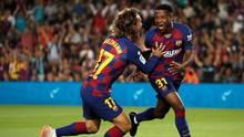 Ansu Fati (r.) jubelt mit Antoine Griezmann über sein frühes Tor gegen Valencia