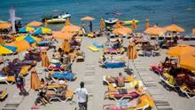 Touristen im Griechenland-Urlaub