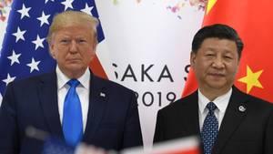US-Präsident Donald Trump (l.) steht neben dem chinesischen Präsidenten Xi Jinping