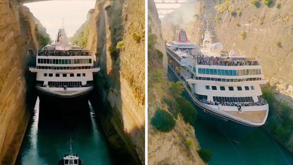 Ein Kreuzfahrtschiff fährt durch einen sehr engen Kanal mit behauenen Felswänden