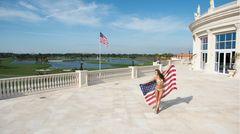 Bild 1 von 10der Fotostrecke zum Klicken: Foto-Shooting auf der Hotelterrasse des Trump National Doral: Nia Sanchez, die Miss USA 2014, zeigt sichmit Sternenbanner.