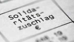 Der Bundestag will den Solidaritätszuschlag abbauen