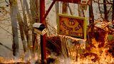 Selbst dieses Schild nahe Taree fällt den Flammen zum Opfer