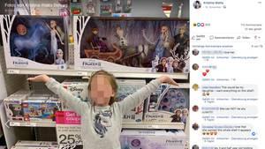 """Emerson steht vor der Produktpalette des Filmes """"Frozen"""" und strahlt"""