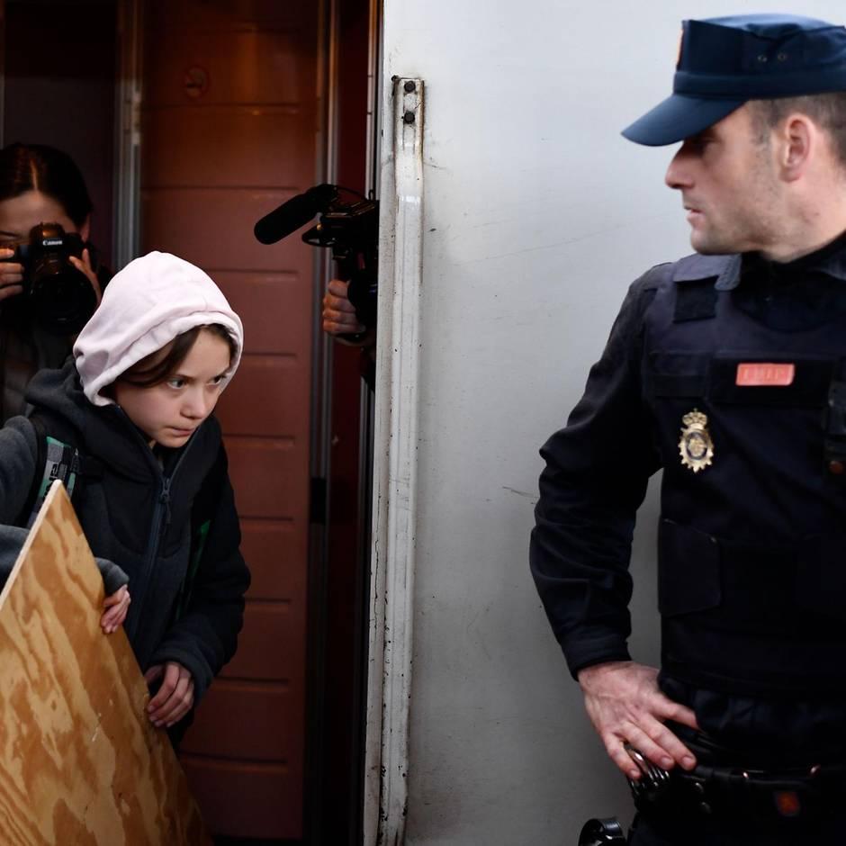 News von heute: Greta Thunberg in Madrid eingetroffen - Sicherheitskräfte begleiten sie aus dem Zug