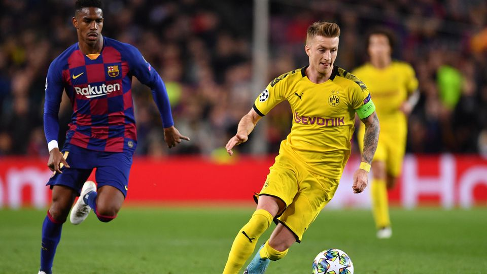 Barcelonas Junior Firpo (l.) und Dortmunds Marco Reus kämpfen in der Champions League um den Ball