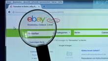 Lupe zeigt auf Ebay-Webseite