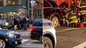 New York: Passanten heben einen SUV an, um eine Frau zu retten