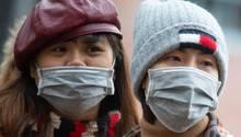 Coronavirus in Deutschland: Asiatische Touristen mit Mundschutzmasken