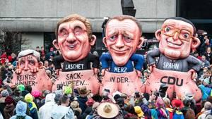 Reine Männersache: Ein Karnevalswagen in Düsseldorf nimmt das Rennen um den CDU-Vorsitz auf die Schippe
