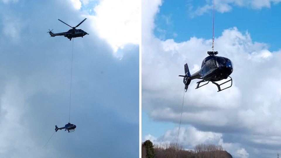Ein Eurocopter wird im nordrhein-westfälischen Velbert von einem Lasthubschrauber geborgen.