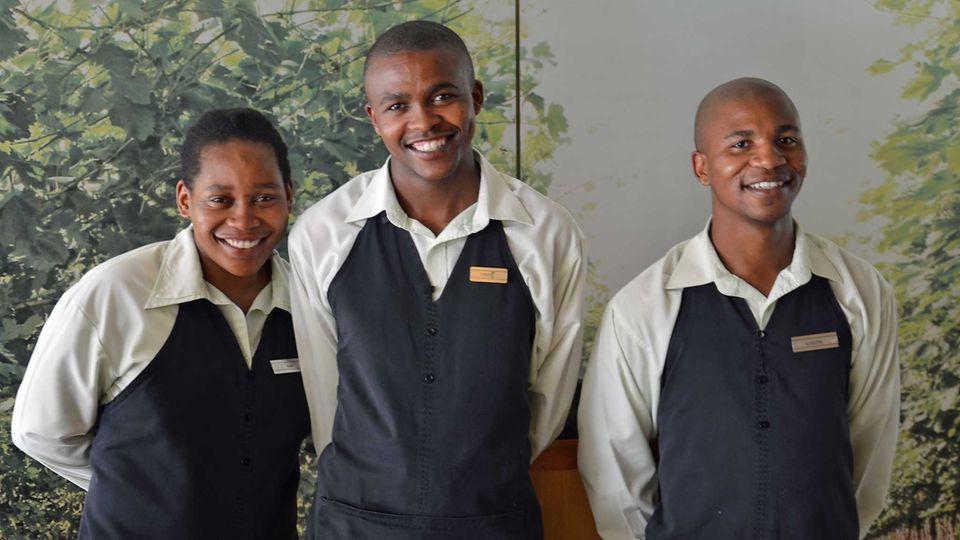 Motiviertes Personal: Frühstücks-Crew in Restaurant Mint in Kapstadt