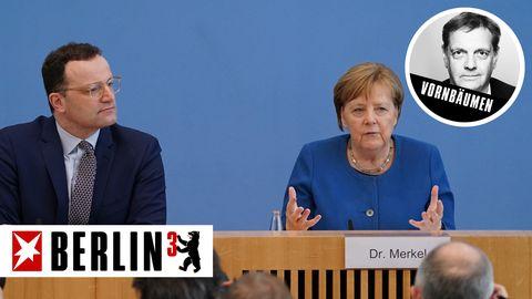 Bundesgesundheitsminister Jens Spahnan der Seite von Kanzlerin Angela Merkel
