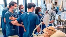 Medizinstudenten stehen um ein Krankenbett mit einer Puppe herum
