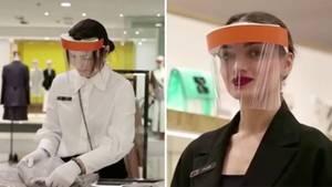 Kaufhausmitarbeiter mit Corona-Schutzmaske