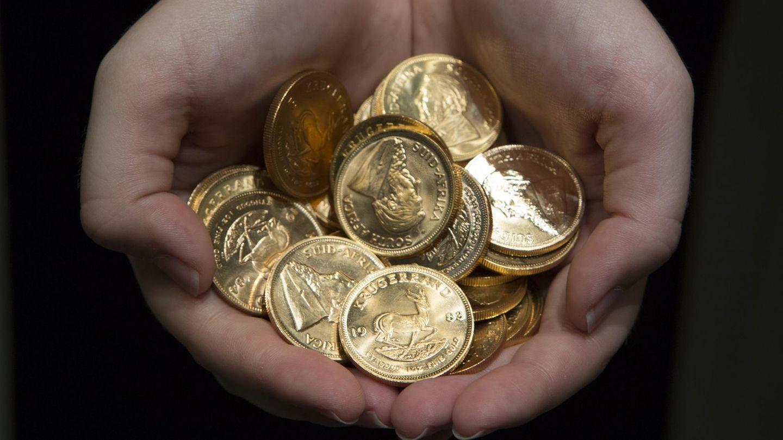 Eine Handvoll Krügerrandmünzen