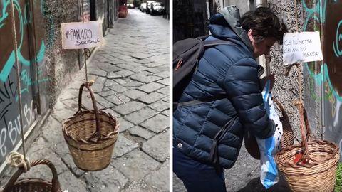 Bewohner in Neapel hängen mit Lebensmitteln gefüllte Brotkörbe aus ihren Fenstern.