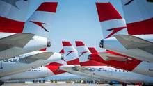 Flugzeuge der Austrian Airlines stehen am FlughafenWien-Schwechat. Seit dem 18. März ruht bis auf Rückholflüge der Betrieb noch bis zum 17. Mai.