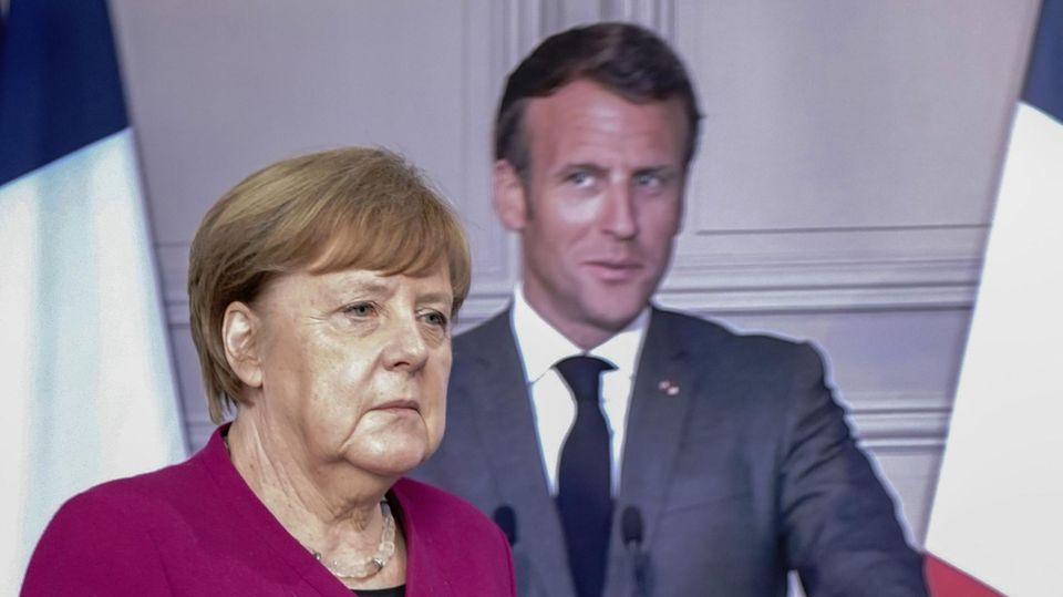 Angela Merkel und Emmanuel Macron bei der Videokonferenz