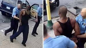 Polizeibeamte nehmen George Floyd fest.
