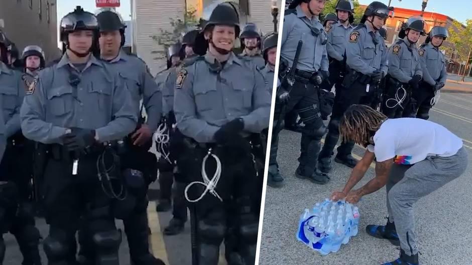 Erfrischende Geste: US-Demonstrant versorgt Polizisten mit Wasser