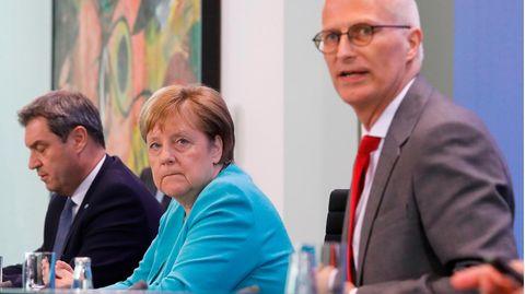 Markus Söder, Angela Merkel und Peter Tschentscher