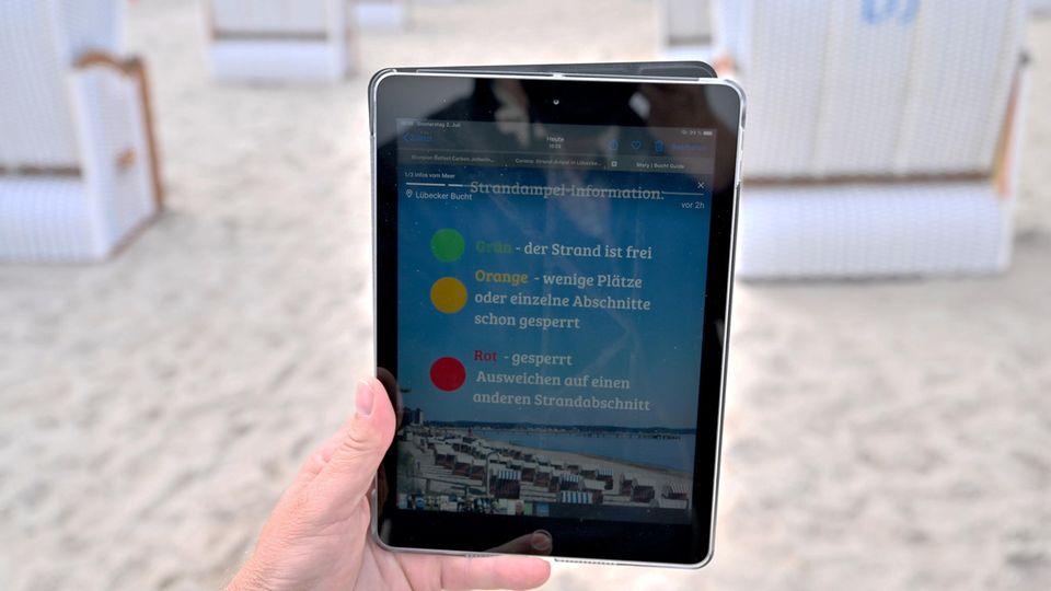 Strand-Ampel auf einem Tablet