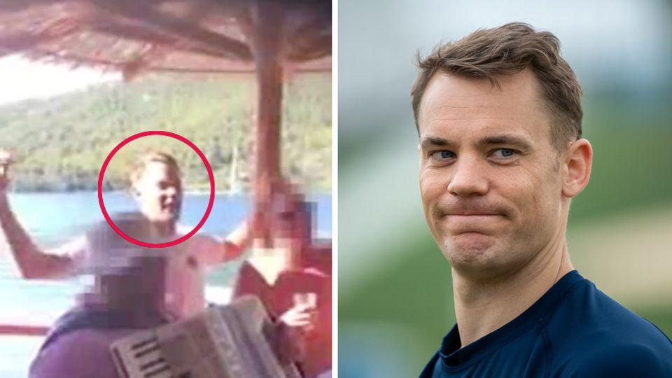 Bayern-Torwart Manuel Neuer steht in blauem Pullover da und kneift die Lippen zusammen