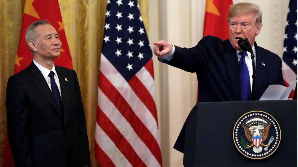 US-Präsident Trump und Chinas Vize-Premier He während einer Pressekonferenz