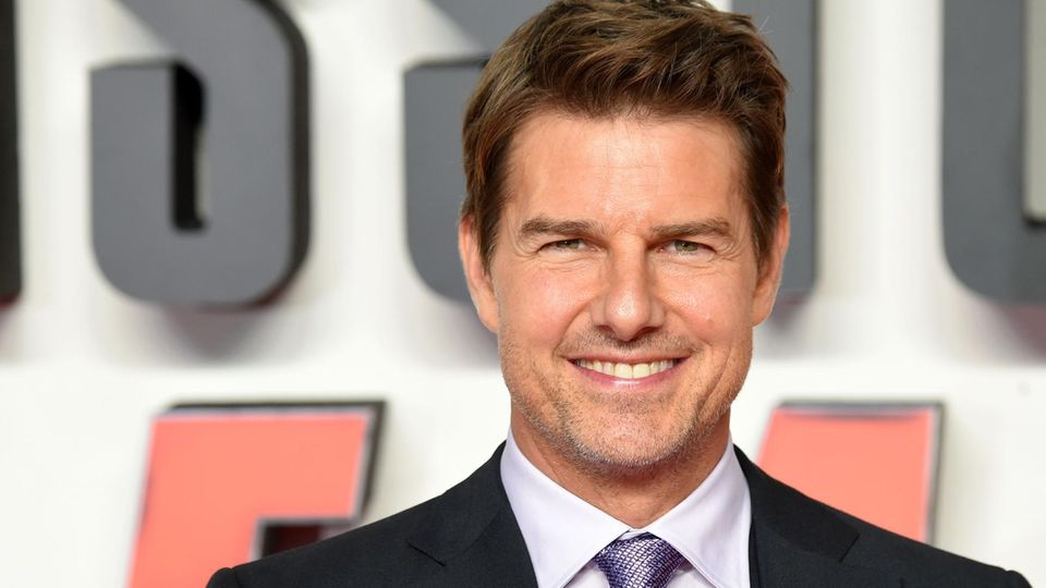 Tom Cruise lächelt in die Kamera