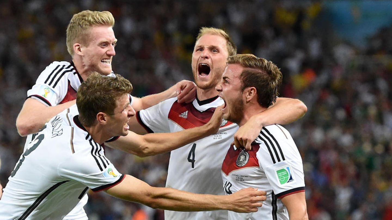Benedikt Höwedes, Mario Götze und André Schürrle jubeln im WM-Finale
