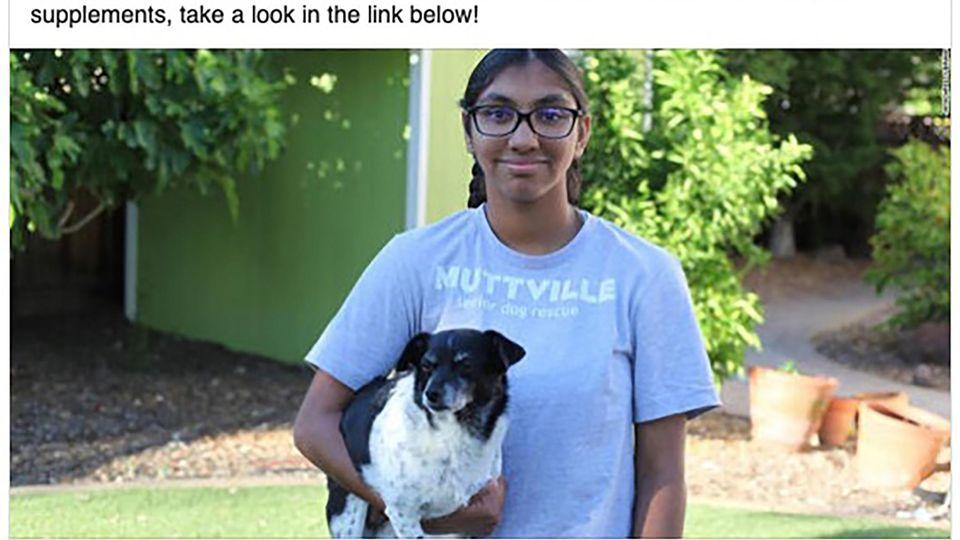 Meena steht mit einem Hund vor dem Tierheim in San Francisco