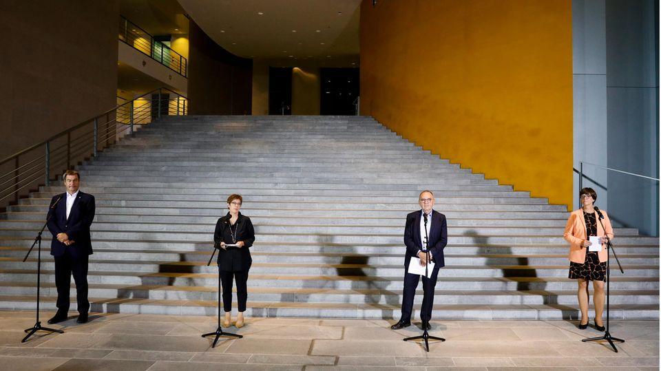 Markus Söder (von links nach rechts), Annegret Kramp-Karrenbauer, Walter-Borjansund Saskia Esken