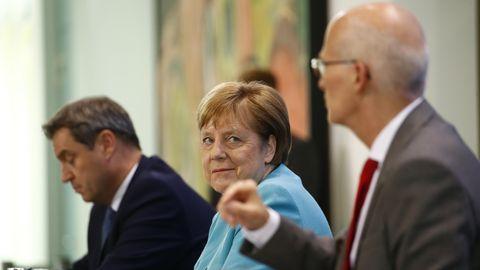 Markus Söder, Angela Merkel und Peter Tschentscher nach Coronavirus-Beratungen