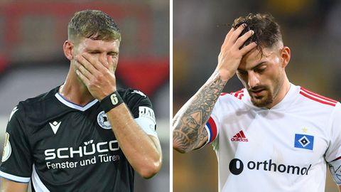 Fabian Klos von Arminia Bielefeld (l.) und Tim Leibold vom Hamburger SV nach ihren Niederlagen im DFB-Pokal